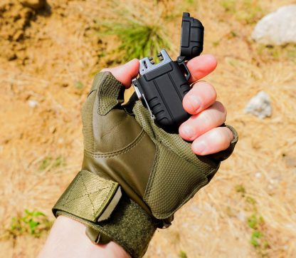 Lighter in tactical glove